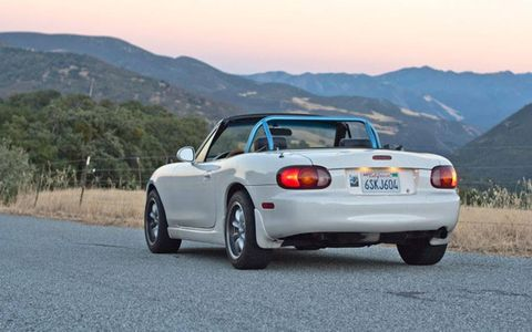 The author painted his roll bar to match his 2000 Miata's blue stripe.