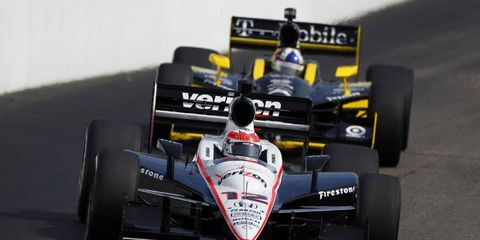 Will Power leads Dario Franchitti early in Sunday's IndyCar race in New Hampshire.