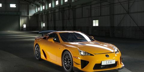 Tire, Wheel, Automotive design, Mode of transport, Yellow, Vehicle, Car, Performance car, Automotive lighting, Rim,