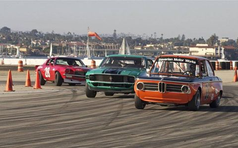 A '68 BMW 2002 battles it out with '70 Boss 302 Mustang in Historic Trans-Am class.