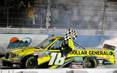 Brian Scott made a late pass to win for truck owner Kyle Busch.