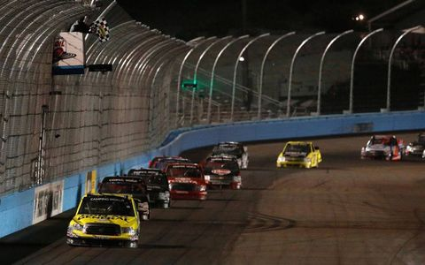 Brian Scott takes the checkered flag on Friday at Phoenix.