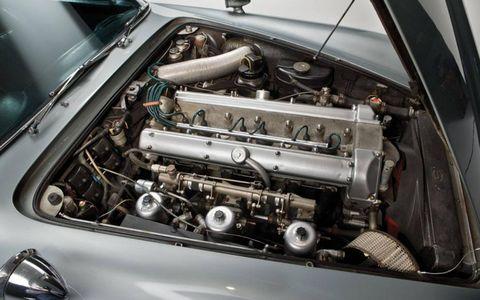 Engine, Automotive engine part, Automotive air manifold, Hood, Automotive super charger part, Personal luxury car, Fuel line, Automotive fuel system, Kit car, Nut,