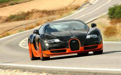 Road, Automotive mirror, Automotive design, Infrastructure, Hood, Car, Performance car, Road surface, Asphalt, Sports car,
