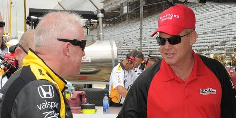 Al Unser Jr., right, talks with Paul Tracy at the Indianapolis Motor Speedway in May.