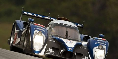 Peugeot driver Anthony Davidson on Friday claimed his second straight pole position for Petit Le Mans at Road Atlanta.