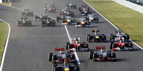 Sebastian Vettel made an aggressive move at the start of the Japanese Grand Prix to keep the McLarens behind him. McLaren's Jenson Button won the race and Vettel finished third to win the season championship.
