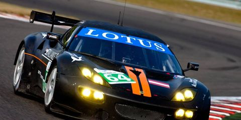 Lotus has pushed back its LMP2 race car project to 2013. A Lotus Evora race car is shown.
