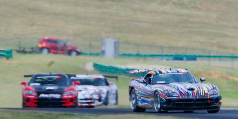 Celebrities raced Dodge Vipers to raise money for charity.