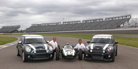 Miles Ahead driving school cofounders Stephan Gregoire (right) and Ted Woerner with two Mini Cooper hardtops supplied for the program.
