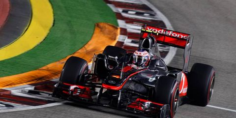 Jenson Button will keep driving for the McLaren Formula One team.