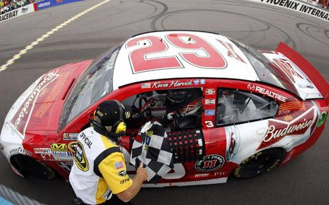 Kevin Harvick receives the checkered flag after winning Sunday's Sprint Cup race in Phoenix.
