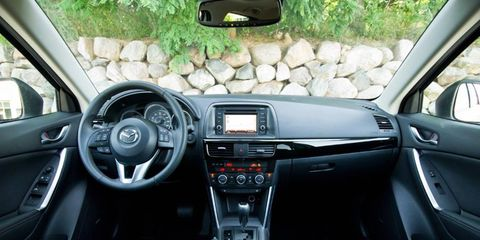 Motor vehicle, Automotive mirror, Steering part, Automotive design, Product, Vehicle, Steering wheel, Center console, Vehicle audio, Car,