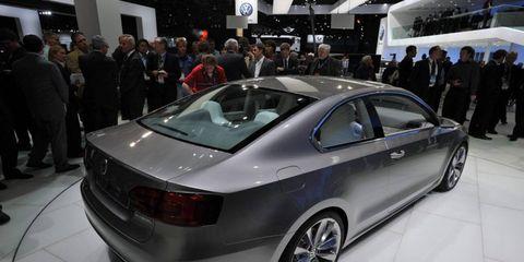 Tire, Wheel, Automotive design, Vehicle, Event, Land vehicle, Car, Personal luxury car, Exhibition, Auto show,