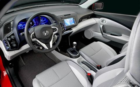 Motor vehicle, Steering part, Blue, Automotive design, Product, Steering wheel, Center console, White, Technology, Vehicle audio,