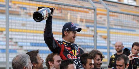 Sebastian Vettel celebrates his Korean Grand Prix victory with his team.