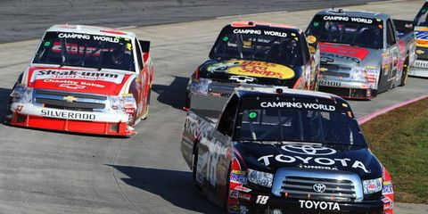 Denny Hamlin's late-race pace earned him the win Saturday in the NASCAR Camping World Truck Series race at Martinsville.