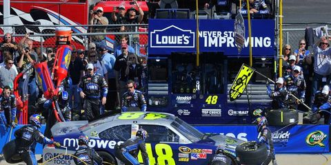 NASCAR officials warned Jimmie Johnson and crew chief Chad Knaus that their car likely will be closely inspected for the rest of the season.
