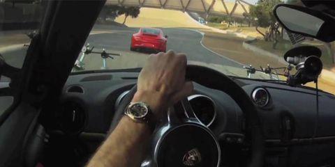 Porsche Cayman R chases a Porsche 911 Carrera S at Laguna Seca