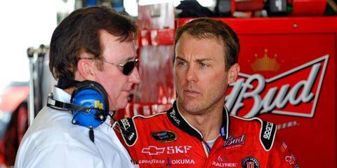 NASCAR team owner Richard Childress, left, talks with driver Kevin Harvick.