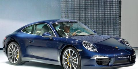 The redesigned 2012 Porsche 911 has a longer wheelbase, which adds to rear-seat room. It goes on sale in February.