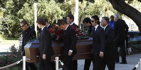 Dan Wheldon was remembered as a champion driver and a family man. Shown is an image from Wheldon's funeral in St. Petersburg, Fla., on Saturday.
