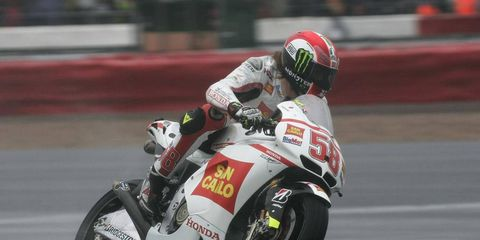 Marco Simoncelli, shown last November, crashed on the second lap of the MotoGP race on Sunday at the Sepang International Circuit. He later died from his injuries.