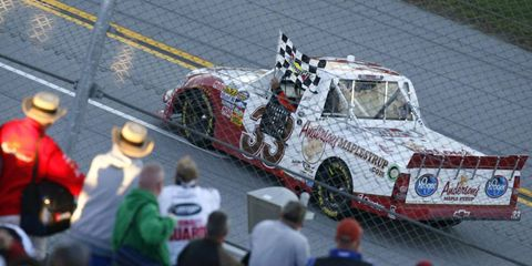 Mike Wallace takes a victory lap at Talladega on Saturday after winning the Camping World Truck Series race.