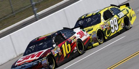 Greg Biffle and Carl Edwards run nose-to-tail during NASCAR practice at Talladega on Friday.