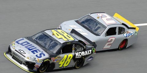 Aric Almirola leads Sam Hornish Jr. during testing of electronic fuel injection by NASCAR at Talladega on Thursday.