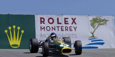 A 1967 Lotus takes to the Laguna Seca racetrack during the 2011 Rolex Monterey Motorsports Reunion.