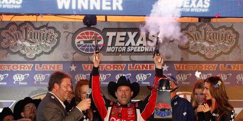 Tony Stewart celebrates his NASCAR win on Sunday at Texas Motor Speedway.