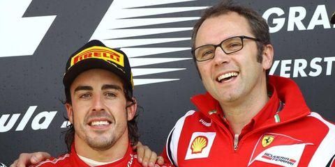 Ferrari team boss Stefano Domenicali, right, celebrates with Fernando Alonso after winning the British Grand Prix.