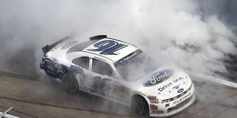 Trevor Bayne got the win at Texas on Saturday with a late-race pass of teammate Carl Edwards.