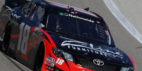 Kyle Busch briefly held the pole position for Saturday's Nationwide race in Texas, but was topped by Elliott Sadler.