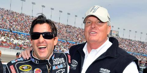 NASCAR team owner Rick Hendrick, right, shown earlier this year with driver Tony Stewart, broke four ribs when the jet he was in ran off the end of the runway.