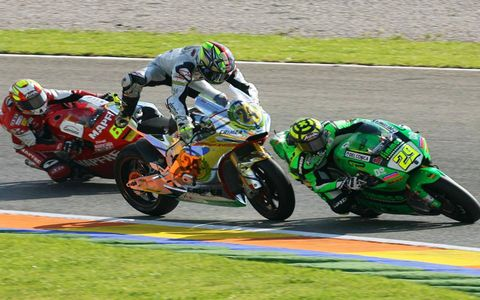 Moto2 racer Toni Elias narrowly avoids crashing into race leader Andrea Iannone in Valencia, Spain, during the first weekend of November.