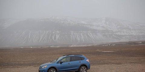 The 2014 Subaru XV Crosstrek Hybrid sloshing around in the mud.