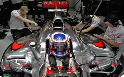 Jenson Button found that his McLaren's cockpit was one of the most secure places he could be in Brazil after narrowly avoiding attack by armed thugs outside of the circuit.