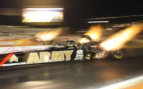 NHRA Top Fuel dragster driver Tony Schumacher lights up the night sky during qualifying for the Las Vegas Nationals at The Strip at the Las Vegas Motor Speedway. Schumacher qualified No. 1 and went on to win the event, his 67th national win.