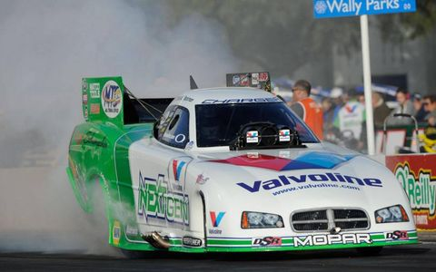 Jack Beckman survived a wild weekend and came away with the season championship in the NHRA Funny Car class.
