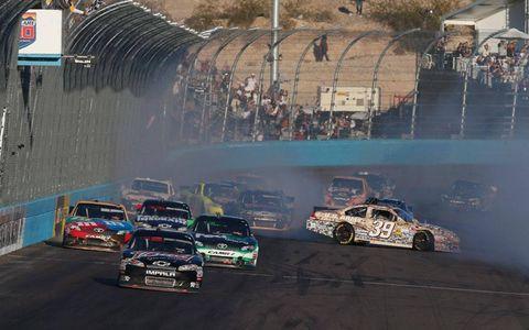 Kevin Harvick takes the checkered flag as mayhem ensues behind him at Phoenix.