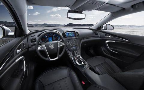 Motor vehicle, Mode of transport, Automotive design, Steering wheel, Transport, Steering part, Automotive mirror, White, Car, Glass,