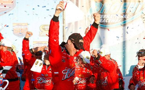 Kevin Harvick survived a wild day to win the NASCAR Cup Series race at Phoenix on Sunday.