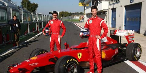 American Michael Lewis, right, and Sergio Campana tested a 2009 Ferrari Formula One car in Italy.