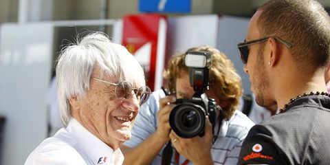 The fate of the U.S. Grand Prix is in the hands of Bernie Ecclestone. The Formula One boss (left) is shown with former champion Lewis Hamilton.