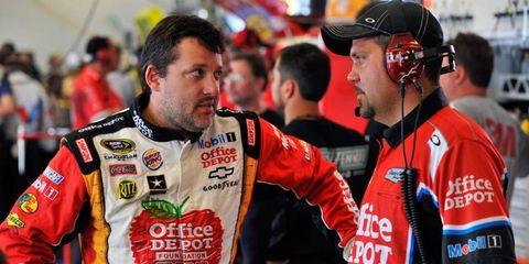 NASCAR Sprint Cup champion Tony Stewart talks with crew chief Darian Grubb at a race earlier this season.