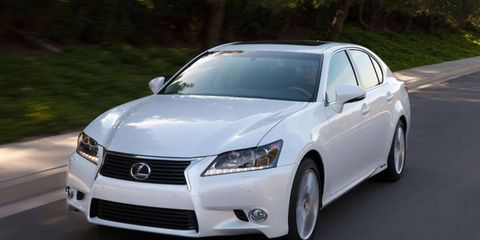 A spindle-shaped grille adds an aggressive touch to the conservative, elegant lines of the 2013 Lexus GS 450h sedan.