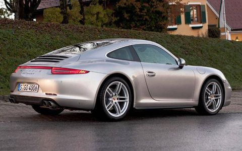 The 2013 Porsche 911 Carrera 4S as seen from the passenger side.