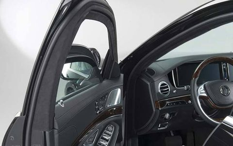 Laminated ballistic glass is several inches thick, and adds several hundred pounds to car's weight.